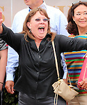 LOUISVILLE, KY - MAY 28: Sportswriter Jennie Rees celebrates I'm a Looker dead heating for a win with Diva Express in the G3 Winning Colors Stakes at Churchill Downs. I'm a Looker is trained by her husband, Patrick Dupuy. (Photo by Mary M. Meek/Eclipse Sportswire/Getty Images)