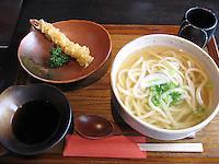 Udon Noodles & Shrimp Tempura.  This is a tasty, traditional Japanese meal of udon noodles, served in bonito-flavoured broth.
