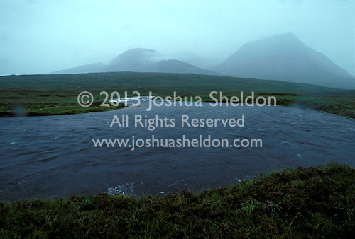 River with mountains showing though the fog<br />