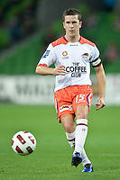 MELBOURNE, AUSTRALIA - DECEMBER 03: Matt McKay of the Roar passes the ball during the round 17 A-League match between the Melbourne Victory and the Brisbane Roar at AAMI Park on December 3, 2010 in Melbourne, Australia. (Photo by Sydney Low / Asterisk Images)
