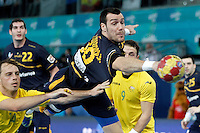 Spain's Gedeon Guardiola (r) and Australia's Mitchell Hedges during 23rd Men's Handball World Championship preliminary round match.January 15,2013. (ALTERPHOTOS/Acero) /NortePhoto