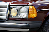 Detail of the front light and the rubber trim of the bumpers of the 1979 Mercedes W123 300 Turbo Diesel from Missouri in the USA, at Gliffaes Hotel near Abergavenny, Wales, UK. Friday 24 August 2019