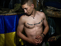 Andre, a Ukranian government soldier, inside the underground bunker where the soldiers sleep and can take cover when they are under bombardment, which happens on a daily basis.