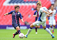 August 06, 2012..Japan's Shinobu Ohno #11 and France's Corine Franco #7 during Semi Final match at the Wembley Stadium on day ten in Wembley, England. Japan defeats France 2-1 to reach Women's Finals of the 2012 London Olympics.