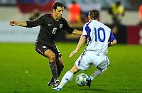 Steve Cherundolo (6) battles against Miroslav Stoch (10). Slovakia defeated the US Men's National Team 1-0 at the Tehelne Pole in Bratislava, Slovakia on November 14th, 2009.