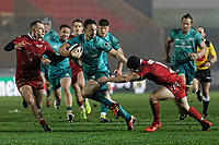 Darren Sweetnam of Muster (C) against Ioan Nicholas (L) and Leigh Halfpenny of the Scarlets (R) during the Guinness Pro14 Round 17 match between the Scarlets and Munster Rugby at the Parc Y Scarlets Stadium, Llanelli, Wales, UK. Saturday 02 March 2019