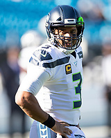 CHARLOTTE, NC - DECEMBER 15: Russell Wilson #3 of the Seattle Seahawks during a game between Seattle Seahawks and Carolina Panthers at Bank of America Stadium on December 15, 2019 in Charlotte, North Carolina.