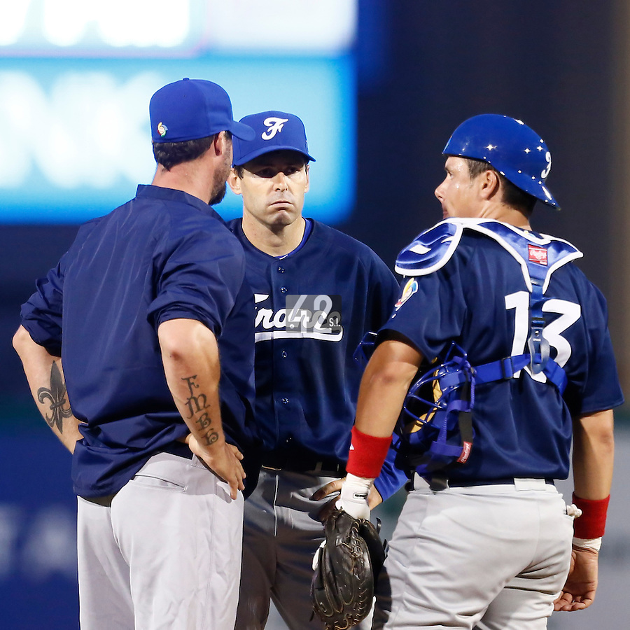20 September 2012: Catcher Boris Marche listens to Eric Gagne, next to Patrice Briones during Spain 8-0 win over France, at the 2012 World Baseball Classic Qualifier round, in Jupiter, Florida, USA.