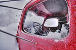 Looking into old truck through broken window