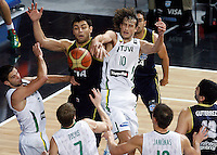 Carlos DELFINO (Argentina) fights for the ball with Simas JASAITIS (Lithuania), Mantas KALNIETIS (Lithuania) left,  during the quarter-final World championship basketball match against Lithuania in Istanbul, Lithuania-Argentina, Turkey on Thursday, Sep. 09, 2010. (Novak Djurovic/Starsportphoto.com).