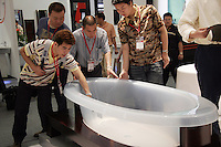 Visitors check out a bath tub on display at the International Building and Construction Trade Fair in Shanghai, China. China's continued building boom has made it the largest market in the world for building materials from end product like shower heads to raw material such as timber..24 May 2005