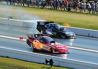 Apr. 29, 2011; Baytown, TX, USA: NHRA funny car driver Melanie Troxel (near) races alongside Terry Haddock during qualifying for the Spring Nationals at Royal Purple Raceway. Mandatory Credit: Mark J. Rebilas-