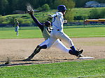 Sequim firstbaseman has the ball in his glove while the Chimacum batter has about 4 inches to the bag.