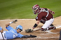 Angel Zarate (40) of the North Carolina Tar Heels slides across home plate ahead of the tag attempt of South Carolina Gamecocks catcher Wes Clarke (28) at Truist Field on April 6, 2021 in Charlotte, North Carolina. (Brian Westerholt/Four Seam Images)