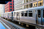 """The Chicago """"L"""" train leaves a station in the Loop, downtown, Chicago, Ilinois"""