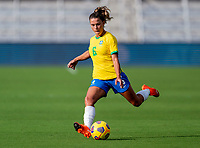 ORLANDO, FL - FEBRUARY 18: Tamires #6 of Brazil crosses the ball during a game between Argentina and Brazil at Exploria Stadium on February 18, 2021 in Orlando, Florida.