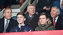 Sir Alex Ferguson takes his seat in the stand at Dens Park.