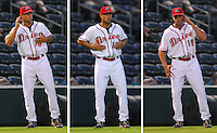 Gabe Kapler, manager of the Greenville Drive for 2007, gives signals from the third base coaches box. Photo by:  Tom Priddy/Four Seam Images