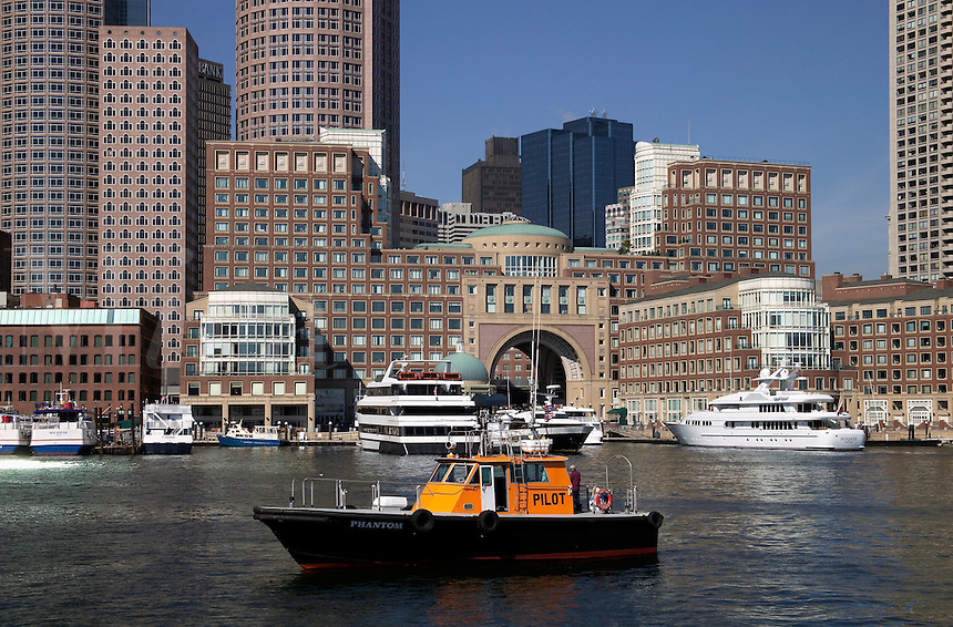Water Taxi on Boston Harbor with Boston, MA skyline in bac