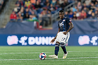 FOXBOROUGH, MA - AUGUST 25: Luis Caicedo #27 of New England Revolution passes the ball during a game between Chicago Fire and New England Revolution at Gillette Stadium on August 24, 2019 in Foxborough, Massachusetts.