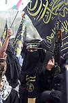 An Islamic Jihad supporter holds a rifle during a rally to mark the 23rd anniversary of the establishment of the Islamic Jihad movement and the assassination of the founder of their movement Fathi Shiqaqi , in Gaza city on Oct. 29,2010 . Photo by Ashraf Amra