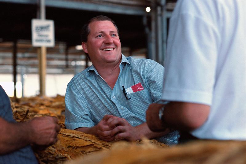 Phil Hando, Buyer (BATA), Mareeba Sales Floor, Mareeba, 2003.
