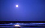 Full moon sets before dawn, Manzanita Beach, Oregon.