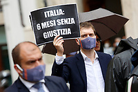 Young lawyers showing banners during the demonstration AIGA, Association of Young Lawyers, in Montecitorio Square, to ask the Government a quick restart of justice activities after the stop due to the Coronavirus pandemic. The banner says Italy 6 months without justice. Rome (Italy) June 11th 2020<br />  <br /> <br /> Photo Samantha Zucchi Insidefoto