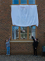 A local families children make a large banner supporting the NHS during the Coronavirus pandemic at Sidcup, Kent, England on 2 April 2020. Photo by Alan Stanford.