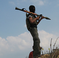 """A Hamas fighter inspects  destroyed by Israeli troops in the central Gaza Strip July 6, 2007. Israeli troops and armoured vehicles crossed into the central Gaza Strip on Thursday, killing 10 Palestinian militants, including nine from the Islamist Hamas group, and a civilian.""""photo by Fady Adwan"""""""