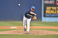 Asheville Tourists pitcher Nate Harris (14) delivers a pitch during a game against the Columbia Fireflies at McCormick Field on April 14, 2018 in Asheville, North Carolina. The Fireflies defeated the Tourists 7-6. (Tony Farlow/Four Seam Images)