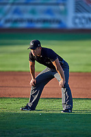 Umpire Shin Koishizawa handles the calls on the bases during the game between the Ogden Raptors and the Orem Owlz at Lindquist Field on September 3, 2019 in Ogden, Utah. The Raptors defeated the Owlz 12-0. (Stephen Smith/Four Seam Images)