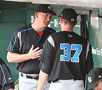 """Syracuse Chiefs starting pitcher Stephen Strasburg (37) talks with pitching coach Greg Booker after the fifth inning during a game vs. the Buffalo Bisons at Coca-Cola Field in Buffalo, New York;  Thursday June 3, 2010.  Syracuse defeated Buffalo by the score of 7-1 as Strasburg picked up his fourth win of the season in """"AAA"""".  Photo By Mike Janes/Four Seam Images"""