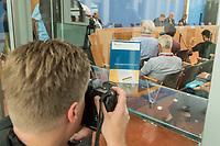 """Bundesinnenminister Horst Seehofer (CSU) und  der Praesident des Bundesamt fuer Verfassungsschutz (BfV), Hans-Georg Maassen stellten am Dienstag den 24. Juli 2018 in Berlin den """"Verfassungsschutzbericht 2017"""" vor.<br /> In dem Bericht werden die Erkenntnisse des BfV zu """"verfassungsfeindlichen Bestrebungen"""" zusammenfasst. Dazu gehoeren Zahlen zur """"Politisch Motivierten Kriminalitaet"""", wie zum Beispiel rechtsextremistische Straftaten. Enthalten sind auch Statistiken und Analysen zu Gruppen, die als militant islamistisch eingestuft werden. Der Termin wurde mehrfach verschoben.<br /> Im Bild: Ein Fotojournalist fotografiert ein Exemplar des Berichtes.<br /> 24.7.2018, Berlin<br /> Copyright: Christian-Ditsch.de<br /> [Inhaltsveraendernde Manipulation des Fotos nur nach ausdruecklicher Genehmigung des Fotografen. Vereinbarungen ueber Abtretung von Persoenlichkeitsrechten/Model Release der abgebildeten Person/Personen liegen nicht vor. NO MODEL RELEASE! Nur fuer Redaktionelle Zwecke. Don't publish without copyright Christian-Ditsch.de, Veroeffentlichung nur mit Fotografennennung, sowie gegen Honorar, MwSt. und Beleg. Konto: I N G - D i B a, IBAN DE58500105175400192269, BIC INGDDEFFXXX, Kontakt: post@christian-ditsch.de<br /> Bei der Bearbeitung der Dateiinformationen darf die Urheberkennzeichnung in den EXIF- und  IPTC-Daten nicht entfernt werden, diese sind in digitalen Medien nach §95c UrhG rechtlich geschuetzt. Der Urhebervermerk wird gemaess §13 UrhG verlangt.]"""