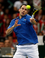 French Davis Cup player Michael Llodra returns the ball during his match against Viktor Troicki of Serbia, Davis Cup finals, Serbia vs France in Belgrade Arena in Belgrade, Serbia, Sunday, 5. December 2010. (credit & photo: Pedja Milosavljevic/SIPA PRESS)