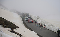 riders up the snow-covered Colle dell'Agnello (2744m)<br /> <br /> stage 19: Pinerolo(IT) - Risoul(FR) 162km<br /> 99th Giro d'Italia 2016
