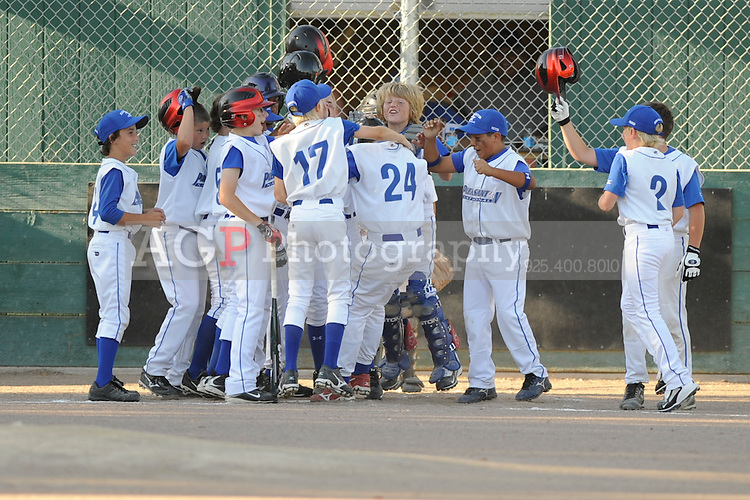 The Pleasanton National Little League twelve year-old All-Stars battle Granada Little League at the Pleasanton Sports Park Wednesday July 1, 2009. Pleasanton won the game 6-1.