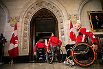 Canadian Olympic and Paralympic flag bearers present Prime Minister Justin Trudeau and the Minister of Sport Carla Qualtrough with a gift at Parliament Hill, Ottawa, Canada, Wednesday November 2, 2016.    COC Photo/David Jackson