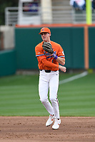 Shortstop Logan Davidson (8) of the Clemson Tigers throws to first base in a game against the South Alabama Jaguars on Opening Day, Friday, February 15, 2019, at Doug Kingsmore Stadium in Clemson, South Carolina. Clemson won, 6-2. (Tom Priddy/Four Seam Images)