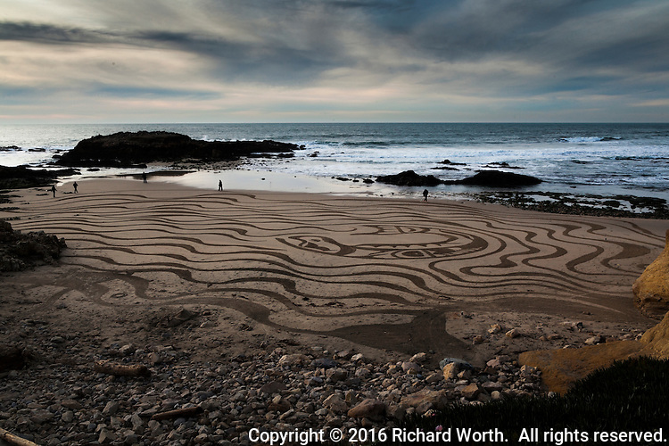 Evocative swirls in the sand.  The whale at the center, surroundered by waves and waves and more waves.  Pescaderso State Beach on California's coast.