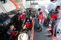 Jul 12, 2020; Clermont, Indiana, USA; Crew members surround the dragster of NHRA top fuel driver Steve Torrence as he warms up his engine in the pits during the E3 Spark Plugs Nationals at Lucas Oil Raceway. This is the first race back for NHRA since the start of the COVID-19 global pandemic. Mandatory Credit: Mark J. Rebilas-USA TODAY Sports