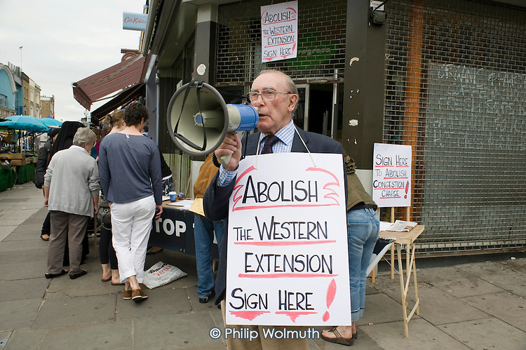 Local residents campaign in Portobello Road market for abolition of the Western Extension of the London Congestion Charge Zone.