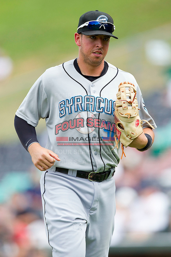 Chris Marrero #30 of the Syracuse Chiefs jogs off the field between innings of the International League game against the Charlotte Knights at Knights Stadium on June 19, 2011 in Fort Mill, South Carolina.  The Knights defeated the Chiefs 10-9.    (Brian Westerholt / Four Seam Images)