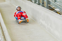 5 December 2014: David Mair, sliding for Italy, crosses the finish line on his first run, ending the day with a 15rd place finish and a combined 2-run time of 1:43.857 in the Men's Competition at the Viessmann Luge World Cup, at the Olympic Sports Track in Lake Placid, New York, USA. Mandatory Credit: Ed Wolfstein Photo *** RAW (NEF) Image File Available ***