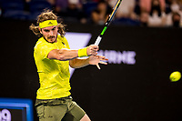 19th February 2021, Melbourne, Victoria, Australia; Stefanos Tsitsipas of Greece returns the ball during the semifinals of the 2021 Australian Open on February 19 2021, at Melbourne Park in Melbourne, Australia.