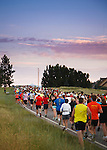 line of runners at the start of the missoula marathon before sunrise