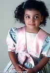 portrait of 3 year old girl closeup vertical in favorite fancy dress