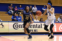 DURHAM, NC - JANUARY 16: Katlyn Gilbert #10 of Notre Dame University passes the ball past Leaonna Odom #5 of Duke University during a game between Notre Dame and Duke at Cameron Indoor Stadium on January 16, 2020 in Durham, North Carolina.