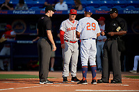 Florida Fire Frogs manager Barrett Kleinknecht (24) during the lineup exchange with Chad Kreuter (29) and umpires John Benken (left) and Dexter Kelley (right) before a Florida State League game against the St. Lucie Mets on April 12, 2019 at First Data Field in St. Lucie, Florida.  Florida defeated St. Lucie 10-7.  (Mike Janes/Four Seam Images)
