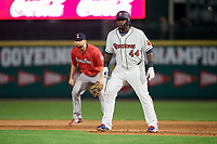 Rochester Red Wings designated hitter Miguel Sano (44) leads off first base in front of Sam Travis (15) during a game against the Pawtucket Red Sox on May 19, 2018 at Frontier Field in Rochester, New York.  Rochester defeated Pawtucket 2-1.  (Mike Janes/Four Seam Images)